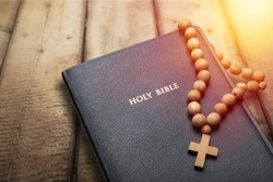 The Holy bible on a wooden table. Christianity concept. Holy Bible background. Christian background. Faith hope love concept.