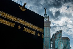 The Holy Kabah with the Clock Tower Building as the background on a cloudy afternoon