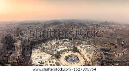 The holy mosque and Makkah city view from the top of Makkah clock tower during sunset. Hajj and event in Makkah