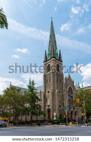 The Holy Name of Jesus Roman Catholic Church is located at W96th St at the corner of Amsterdam Avenue Manhattan , New York City. The statue of Virgin Mary stands at the corner of Amsterdam Avenue.