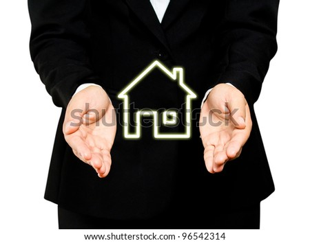 The home in Business hands - stock photo