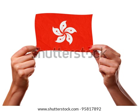 The Hong Kong flag in the woman hands. closeup