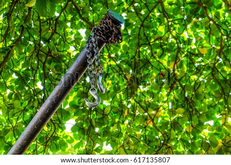 the hook hangs on the pole in the green background #617135807