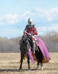 The horse knight with a sword in a hand