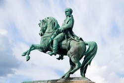 The horse monument to Napoleon I Bonaparte against the cloudy sky , Rouen, Normandy, France. It is created in 1865