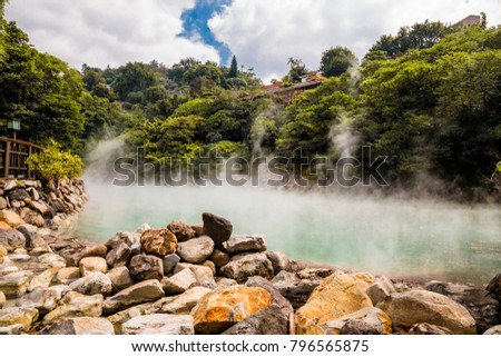 The hot spring at Beitou Thermal Valley, covered with mists, is nearly 100 degrees Celsius hot. The rocks in this photo are rare and called hokutolite. They contain the radioactive element Radium.