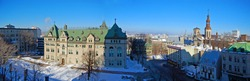 The Hotel de Ville City Hall and Basilique Notre-Dame-de-Quebec panorama in winter, Quebec City, Quebec, Canada. Historic District of Quebec City is UNESCO World Heritage Site since 1985.