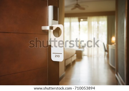 The hotel room with Room Number sign on the door #710053894