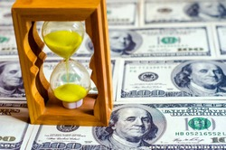 The hourglass is in dollars as a symbol of capital creation by its own work