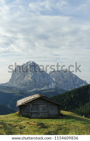 The house, against the background of the mighty mountains in the South Tyrol #1154609836