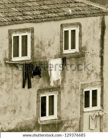The house drying clothes on a small street  in the old quarter of Ribeira - Porto, Portugal (stylized retro)