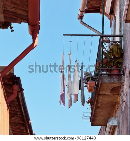 The house drying clothes on a small street  in the old quarter of Ribeira - Porto, Portugal
