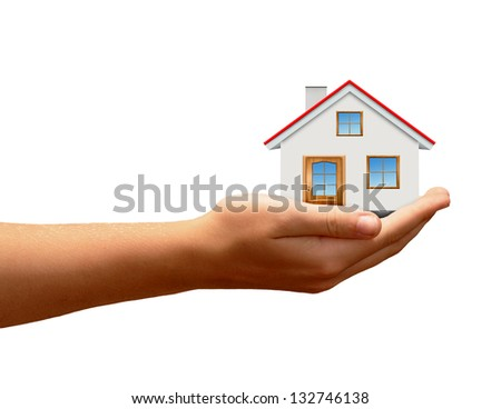 The house in hands isolated on white background