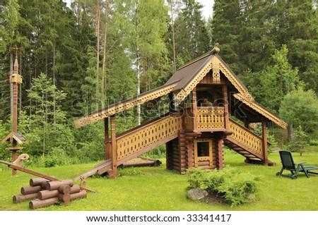 The house on a hill with a wooden carved roof