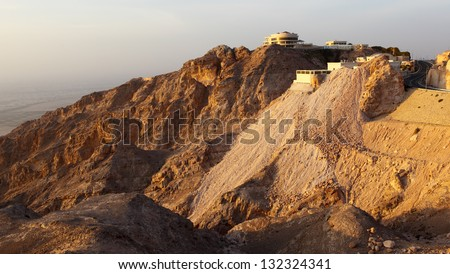 The house on mountain is shown on a sunset. AL AIN. United Arab Emirates
