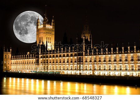 The Houses of Parliament in London at night with a bright full moon
