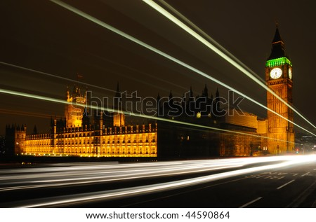 The Houses of Parliament in the evening rush hour, viewed from Westminster Bridge, with traffic trails in the foreground.