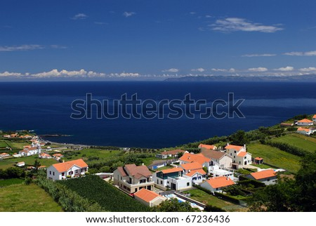 The houses on coast of the Faial island