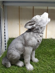 The howling white wolf baby statue.