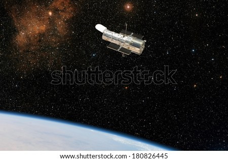 The Hubble Space Telescope observes deep space while in orbit above the Earth. Elements of this image furnished by NASA.