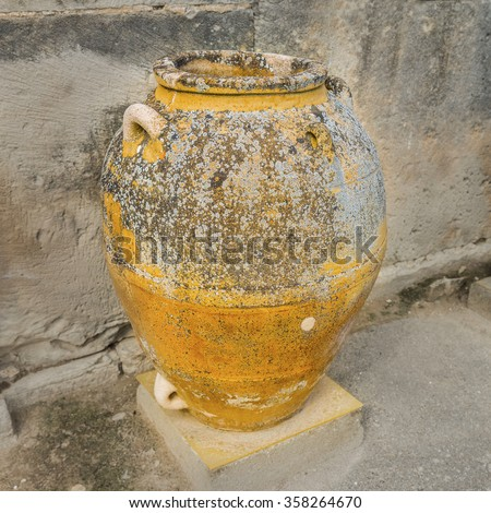 The huge  Minoan Cretan pot, or pithoi, in to the storages of the ancient Minoan Palace of Phaistos( Festos ).Located on the plateau of Messara.District of Heraklion.Crete island.Greece.Europe.