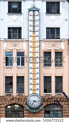 The huge thermometer on the building. Very big measuring instrument. Meteorological research. Weather change. Weather forecast concept. #1426772522