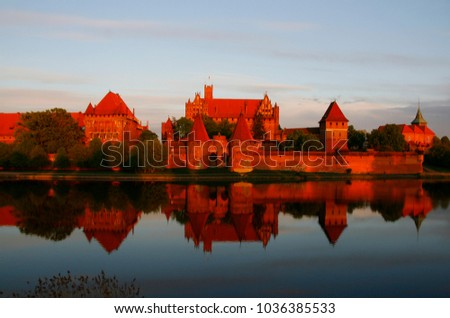 The hugest brick fortress in the world, the castle of the Teutonic Knights Order in Malbork (Poland, historical Prussia) on a sunset. UNESCO world heritage site. Fairy-tale medieval castle.