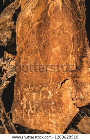 """The """"hula hoop"""" anthropomorph petroglyphs at Mcconckie Ranch in Dry Fork Canyon near Vernal, Utah, USA. This unique rock art seems to depict warriors (or possible ancient aliens) in a halo or shield. #1200628510"""
