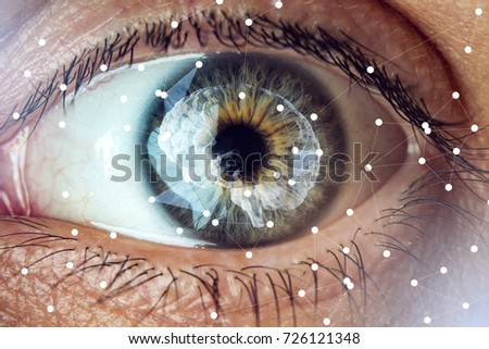 The human eye with the image of the brain in the pupil. The concept of artificial intelligence and the limitless possibilities of the mind