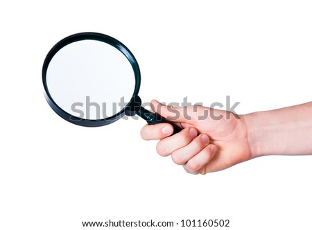 the human hand holding a magnifying glass on a white background