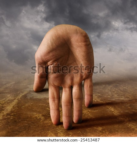 The human hand on the foggy landscape. surreal artwork