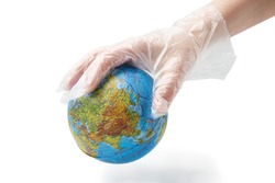 The humanhand in plastic glove holds the planet earth.  Isolated white background.