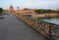 The hundreds of thousands of romantically love inscribed padlocks on the Pont Des Arts Bridge, Paris France.