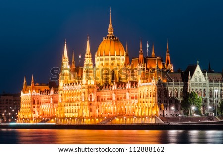 The Hungarian Parliament Building is the seat of the National Assembly of Hungary, one of Europe's oldest legislative buildings, a notable landmark of Budapest. Night-view with Danube river.
