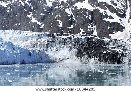 The ice is falling from the melting dirty glacier in Glacier Bay national park, Alaska.