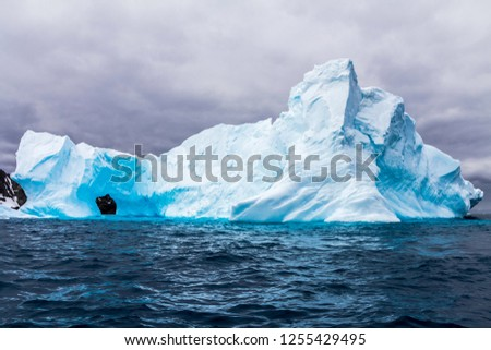 The icebergs and mountains in Antarctica the white continent #1255429495