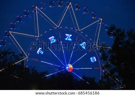 the iconic ferris wheel towers...