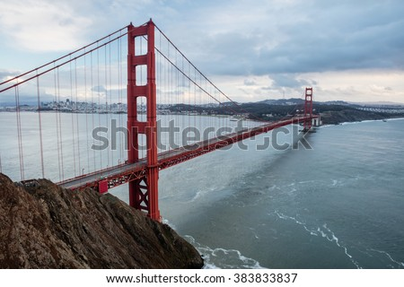The iconic Golden Gate bridge extends across the San Francisco Bay from the Marin headlands to the beautiful city of San Francisco. The bridge is a symbol of the city and northern California.