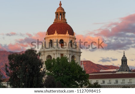 The iconic Pasadena City Hall in Los Angeles county. Image taken against beautiful and vibrant sunset light. The San Gabriel Mountains are visible in the background.