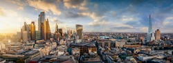 The iconic skyline of London, United Kingdom, during sunset time with golden light and reflections in the modern skyscrapers