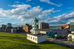 The iconic 120 year old town clock Halifax, an historic landmark of Halifax, Nova Scotia. Halifax Downtown as seen from Citadel Hill overlooking the Town clock and business and residential buildings