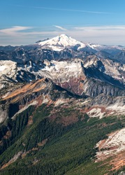 The Icy Peak of Mt Baker Towers over The North Cascades as Viewed from Eldorado Peak. North Cascades National Park, Washington.