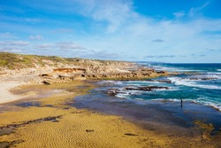 The idyllic Pearses Beach and headland around Pirates Bay Cove on a hot summer's day near Blairgowrie, Victoria, Australia