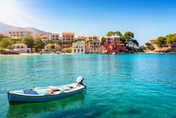 The idyllic village of Assos on the Ionian island of Cephalonia, Greece, with emerald sea and colorful, red roofed houses until the beach