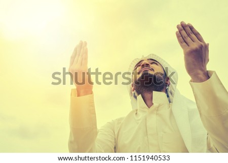 The iIslamic man praying   on the mountain. #1151940533