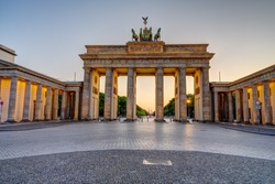 The illuminated Brandenburg Gate in Berlin after sunset with no people