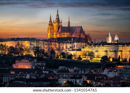 The illuminated, famous Castle of Prague, Czech Republic, situated over the old town just after sunset time Stock photo ©