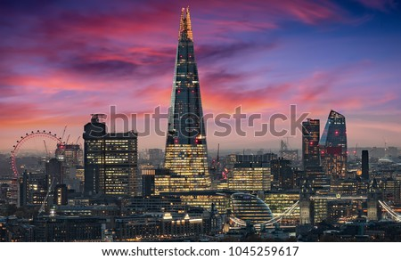 The illuminated skyline of London, United Kingdom, during an intense sunset