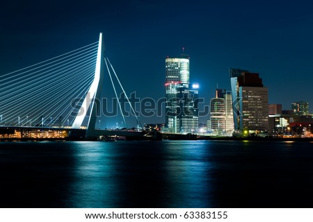 The illuminated Skyline of Rotterdam, Netherlands at night - stock photo