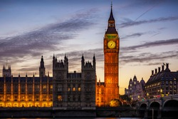 The illuminated Westminster Palace and Big Ben clock tower, major tourist attraction and Parliament in London just after sunset
